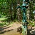Hand-pump water station.- Sugarloaf 2 Campground