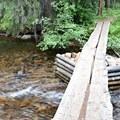 Bridge across Cascade Creek above the falls.- Crater Lake via Cascade Creek