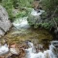 One of many side creeks of crystal-clear water.- Crater Lake via Cascade Creek