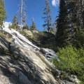 The creek pours out of Boulder Lake down a steep granite slide.- Boulder Lake