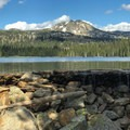 Boulder Lake dam gives the resemblance of an infinity pool with Buckhorn Mountain above.- Boulder Lake