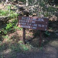 Sign near the trailhead indicating distances.- Boulder Lake