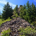 The trail is almost indiscernible as it weaves through a scree field nearing the lookout site.- Henline Mountain