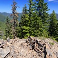 A rock wall has been built to make the trail obvious through the high scree field.- Henline Mountain