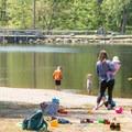 Kids playing at the beach area.- Schreeder Pond