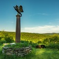 The steel column at the hilltop scenic viewpoint.- Dog Mountain + Dog Chapel