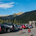 The trailhead parking area with two bathrooms.- Forest Lakes + Needle Eye Tunnel