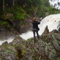 A hiker capturing a picture of the falls.- Wilmington Notch Campground