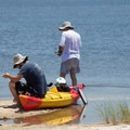 Kayakers landing on the island.- Jane's Island State Park