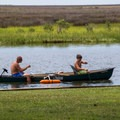 A family crabbing in their canoe.- Jane's Island State Park