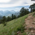 Climbing up open meadows on the side of the mountain offer sweeping views of the surrounding valleys and mountains.- Deer Mountain