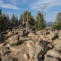 The rocky area at the Deer Mountain summit offers near 360-degree views of Estes Park and the east side of Rocky Mountain National Park.- Deer Mountain