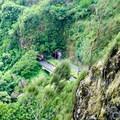 The Pali Highway tunnel buzzes below.- Pali Puka