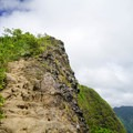 The trail hugs the cliff edge.- Pali Puka