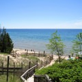 A lake view from top of a dune in Whitefish Dunes State Park.- Red Trail