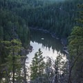 The lake as viewed from the road in. This deep narrow lake snakes through the forest.- C.C. Cragin Reservoir