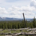 Hiking the Dogshead Trail with the Red Mountains and Lewis Lake in the background.- Lewis Lake to Shoshone Lake Loop