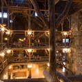 The lobby has a unique log and limb structure.- Old Faithful Inn
