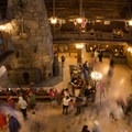 The massive 85-foot-tall rhyolite stone fireplace is the centerpiece of the lobby.- Old Faithful Inn