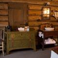 A room with a shared bath in the hallway.- Old Faithful Inn
