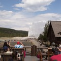 Guests watching Old Faithful from the viewing deck.- Old Faithful Inn