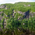 A look across Chapel Pond at the side of Round Mountain, a popular area for rock and ice climbing.- Rock Garden Falls