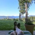 Relaxing on the back patio at Rae Leigh Heights Bed and Breakfast.- Rae Leigh Heights Bed + Breakfast