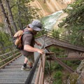 The staircase is anchored to the adjacent cliffside.- Artist Point to Uncle Tom's Trail