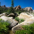 Alpine streams crisscross the trail as you continue climbing.- Alta Peak
