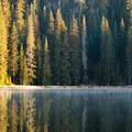 First light hits Lower Twin Lake.- Twin Lakes Loop