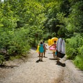 Summer friends heading down to the quarry on a 100-degree Tennessee July day.- Fork Dickerson Quarry
