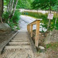Staircase leading down to the water.- Lady's Bathtub Swimming Area