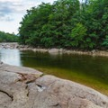 Open rocks make for a nice place to sit and enjoy the river.- Lady's Bathtub Swimming Area