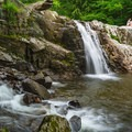 The upper falls are the most popular among swimmers.- Buttermilk Falls Swimming Hole