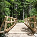 Footbridge near the campground leading to Erma Bell Lakes.- Skookum Creek Campground