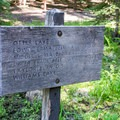 Trailhead sign in the campground.- Skookum Creek Campground