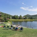Grassy lawns and a small sandy beach greet the kayakers and stand-up paddleboarders.- Deer Valley Ponds