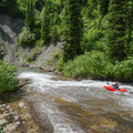 The last part of the slide ends in a clear pool, and the river makes another turn down the steep landscape.- Siyeh Creek to St. Mary's Lake via Reynolds Creek