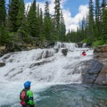 """Running the short section below the last portage (portage is optional) and making sure to have someone to """"catch"""" paddlers in the pool above the next drop.- Siyeh Creek to St. Mary's Lake via Reynolds Creek"""