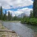 Clear water, gravel bars, and slow current provide a nice break. This area had evidence of bear activity, and it was far from any trail. Make portages with haste to avoid an encounter with any bear.- Siyeh Creek to St. Mary's Lake via Reynolds Creek