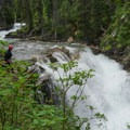 The last waterfall on the first gorge of Reynolds Creek. Scout the whole set of drops before committing to the gorge. Scout and portage is on the right.- Siyeh Creek to St. Mary's Lake via Reynolds Creek