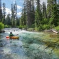 Lucid water and colorful bedrock formations.- Siyeh Creek to St. Mary's Lake via Reynolds Creek