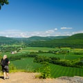 A hiker pauses to enjoy the view.- Vroman's Nose