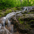 A cascading waterfall just off the trail.- Burnt Rock Mountain via Hedgehog Brook Trail