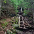 There are a few wooden stairs to help aid hikers.- Burnt Rock Mountain via Hedgehog Brook Trail