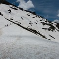 Col du Bonhomme covered in snow into July.- Tour Du Mont Blanc (TMB) Overview