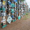Try to find your own hometown in the forest of signs.- Sign Post Forest