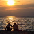 A couple enjoys the setting sun over the Chesapeake Bay.- First Landing State Park