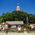 A view of the lighthouse from the parking lot.- Cape Henry Lighthouse