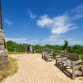 Benches sit along the edge of the path.- Cape Henry Lighthouse